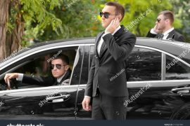 stock-photo-handsome-bodyguards-near-car-outdoors-717267091